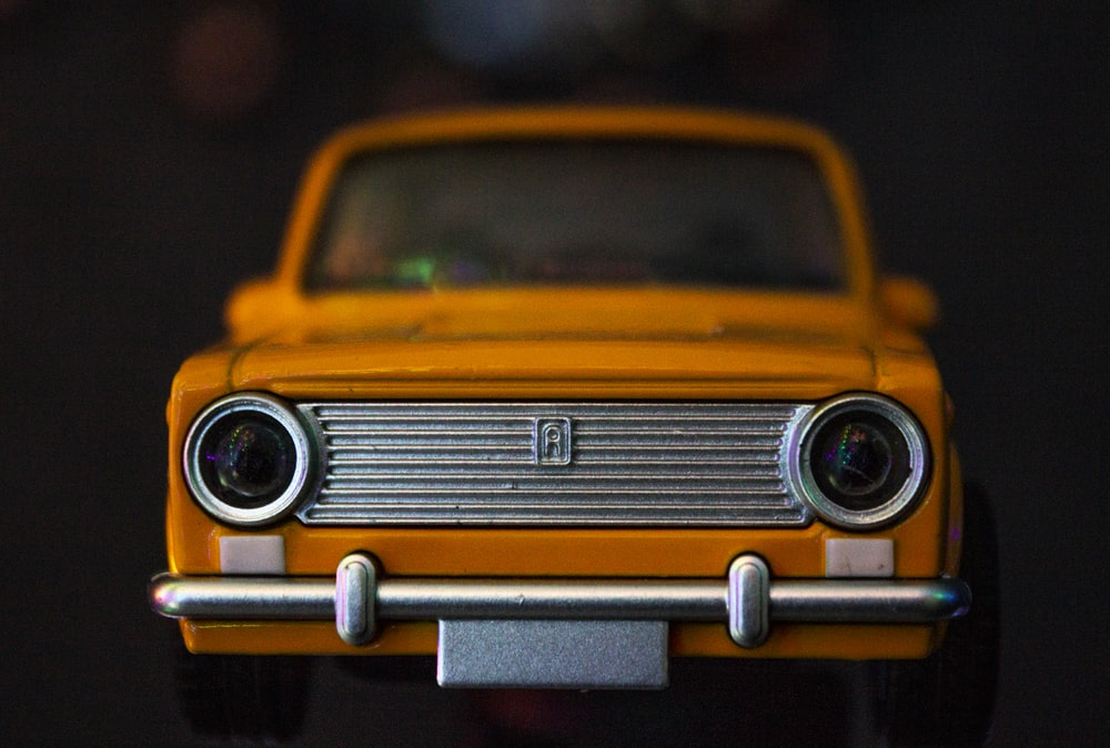 yellow and black classic car scale model