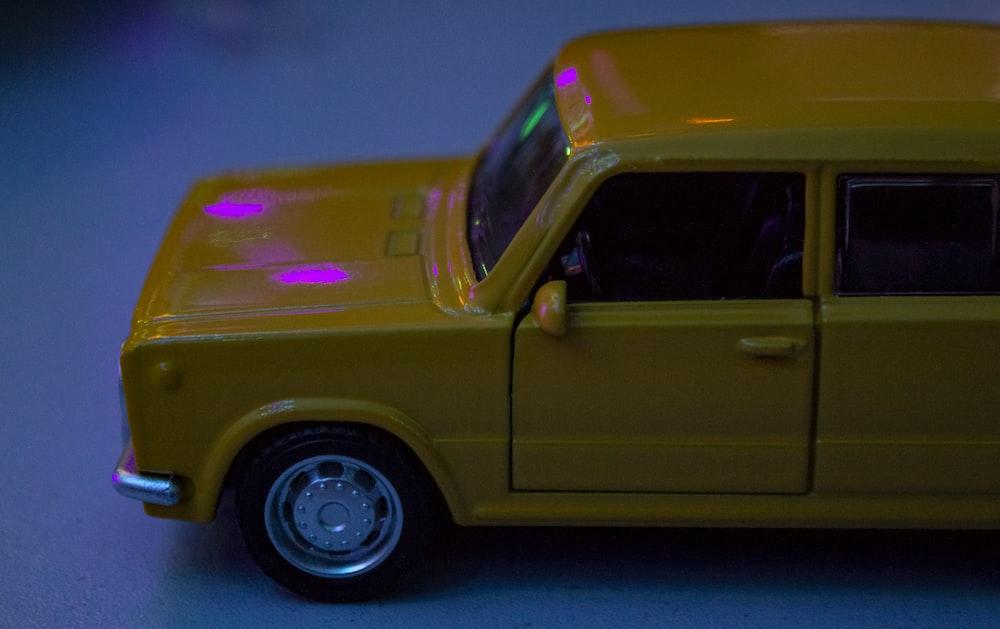 yellow car with purple lights