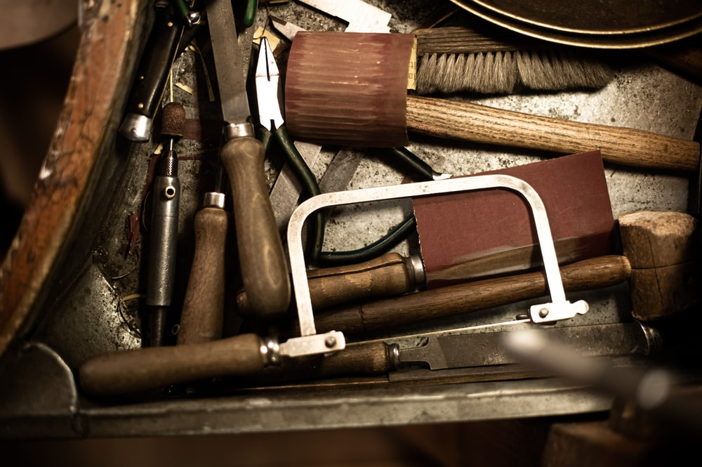 brown and silver hand tools