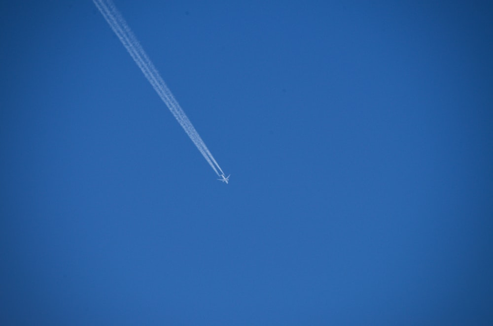 white plane in the sky