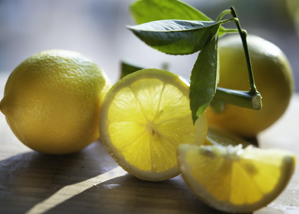 yellow lemon fruit on brown wooden table
