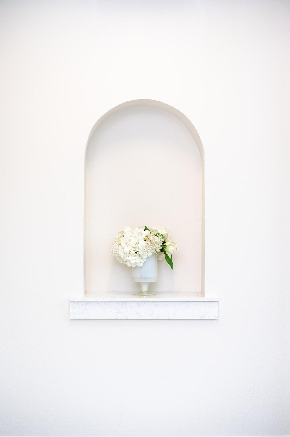 white flower bouquet on white ceramic vase