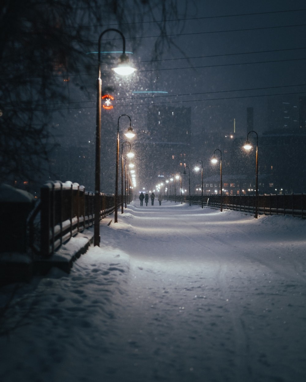 snow covered road during night time