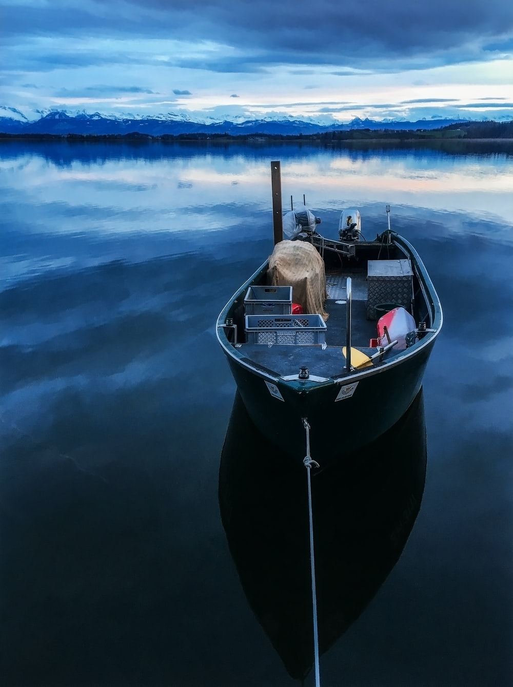 black boat on body of water during daytime