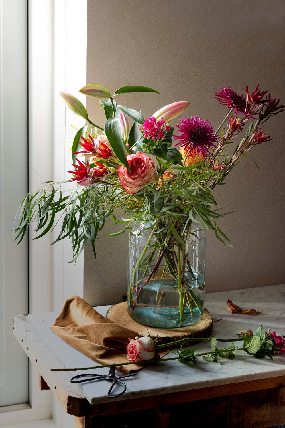 red flowers in blue glass vase