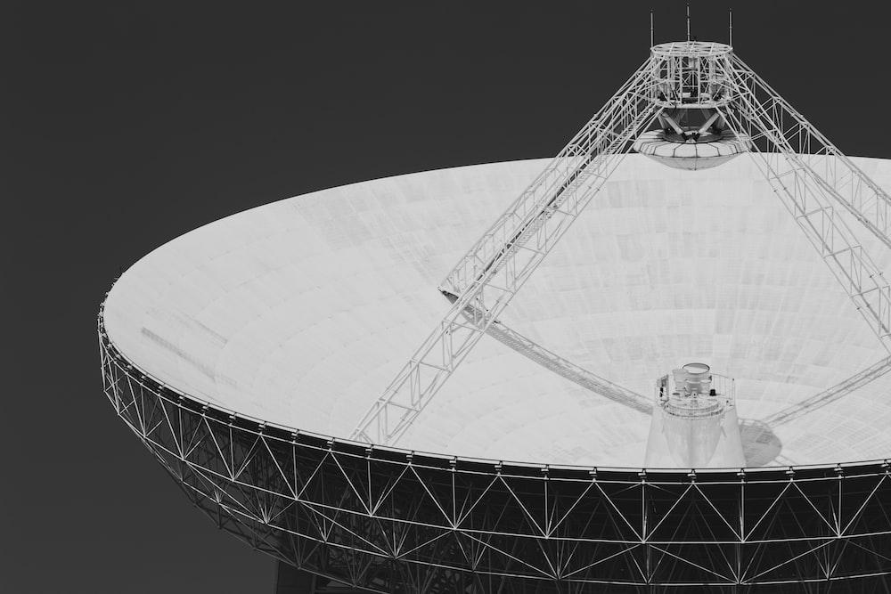 grayscale photo of satellite dish