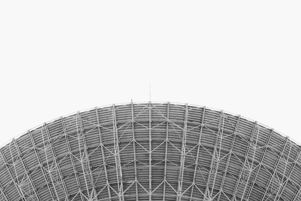 white round building under white sky