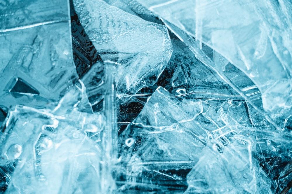 grayscale photo of broken glass
