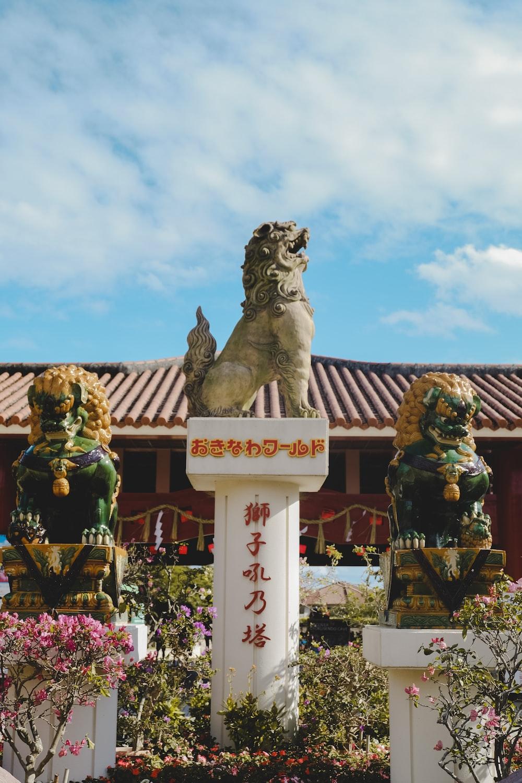 brown lion statue under blue sky during daytime