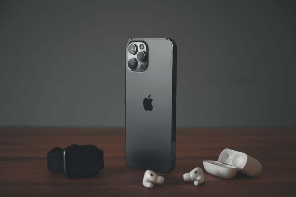 black iphone 7 with white and black dice