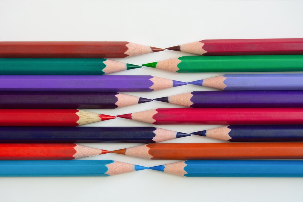 multi color coloring pencils on white surface