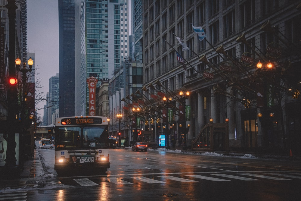 black bus on road during night time