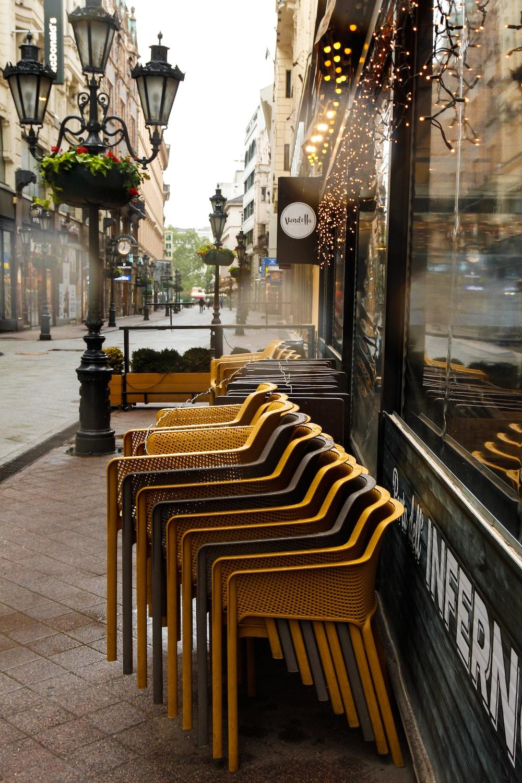 black metal framed brown wooden chairs