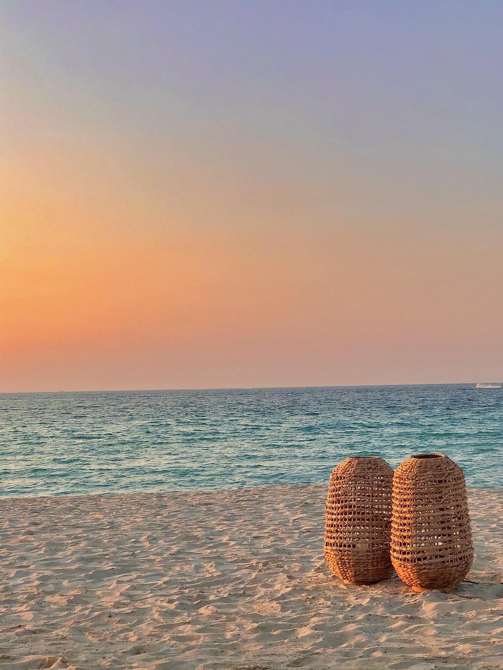 brown wicker basket on beach during sunset