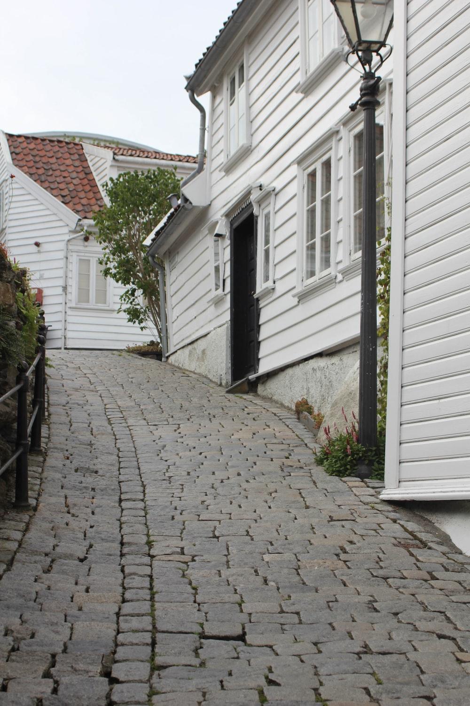 white wooden door near brown brick wall