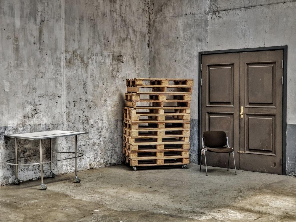 brown wooden crates beside brown wooden door