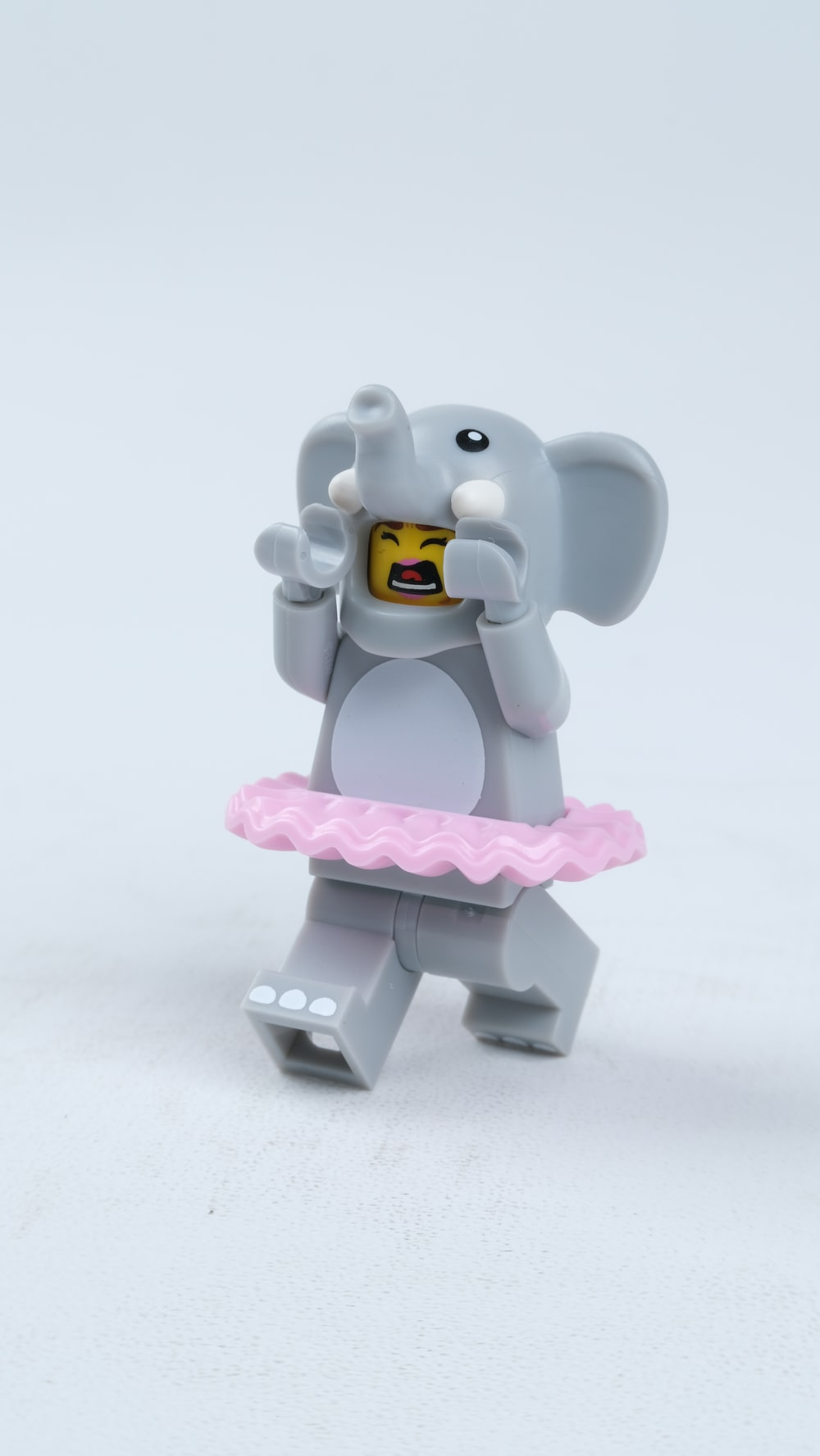 purple elephant figurine on white surface