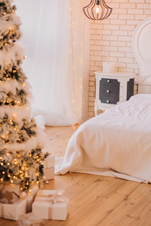white bed near christmas tree