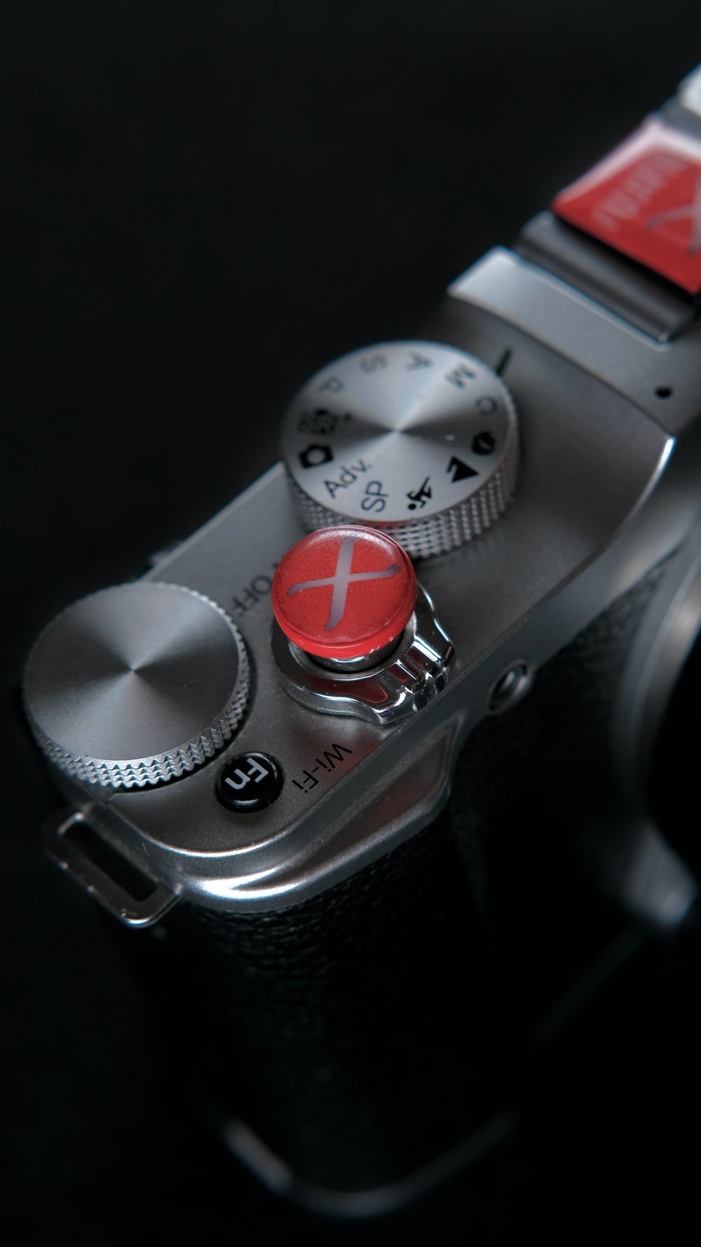 silver and red round analog watch