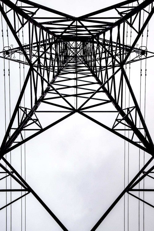 black metal tower under white clouds