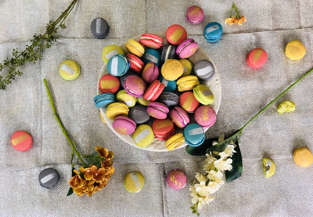 assorted candies on green textile