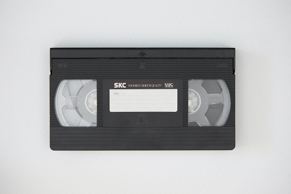 black cassette tape on white textile