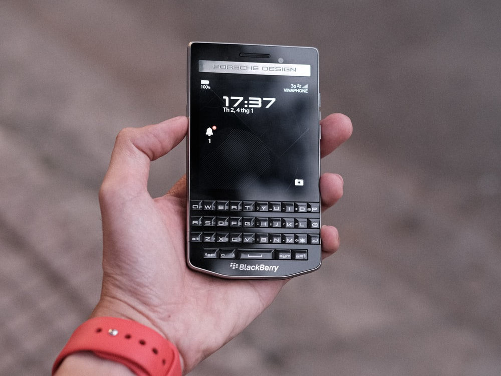 person holding black sony xperia