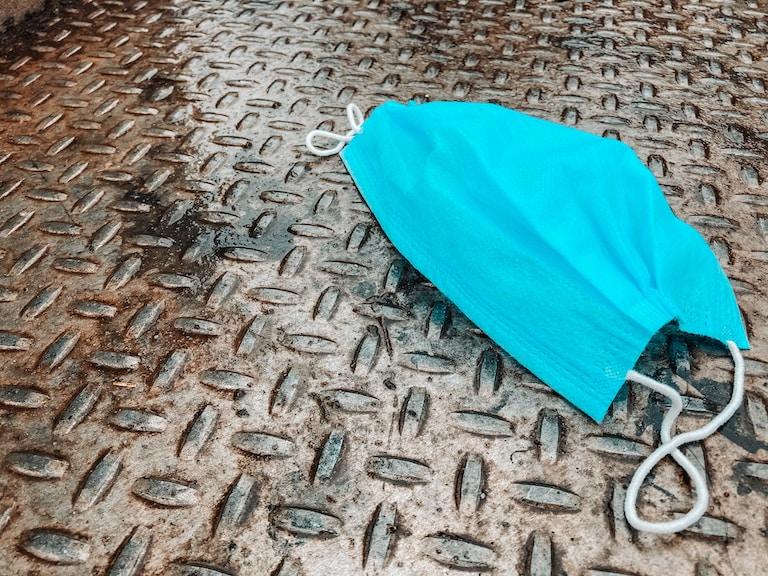blue umbrella on brown textile