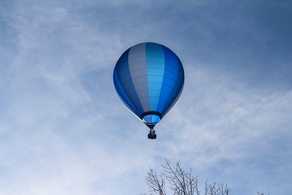 blue and white hot air balloon under blue sky during daytime