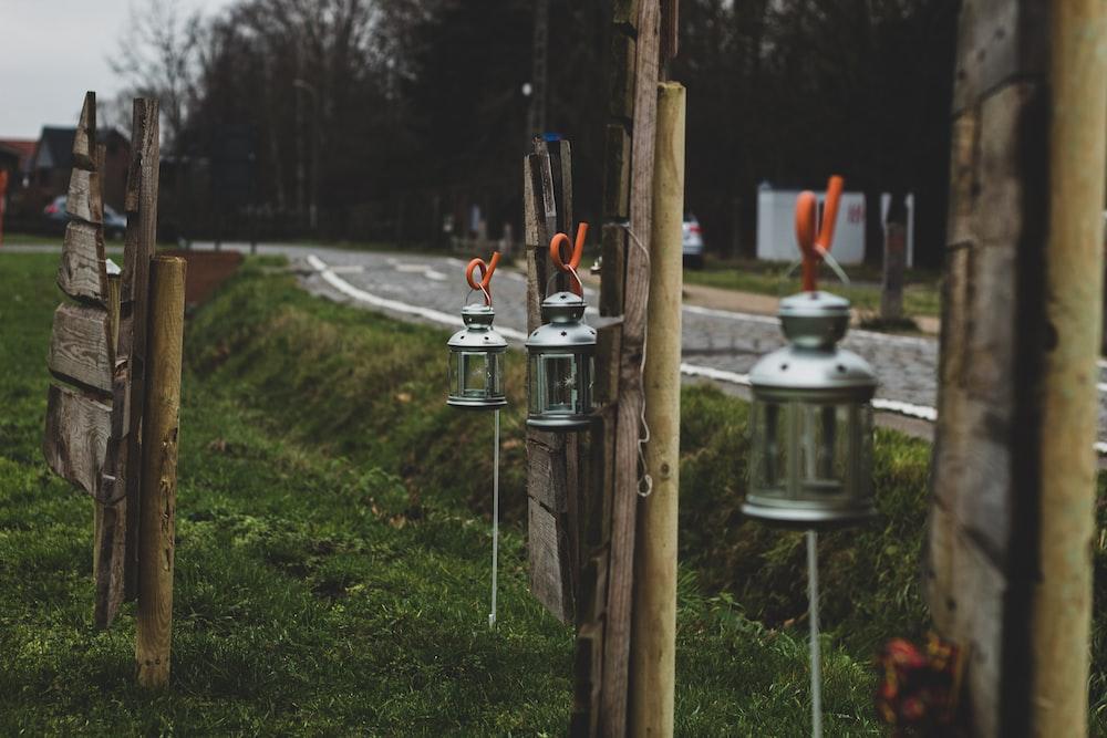 silver fire hydrant on green grass field