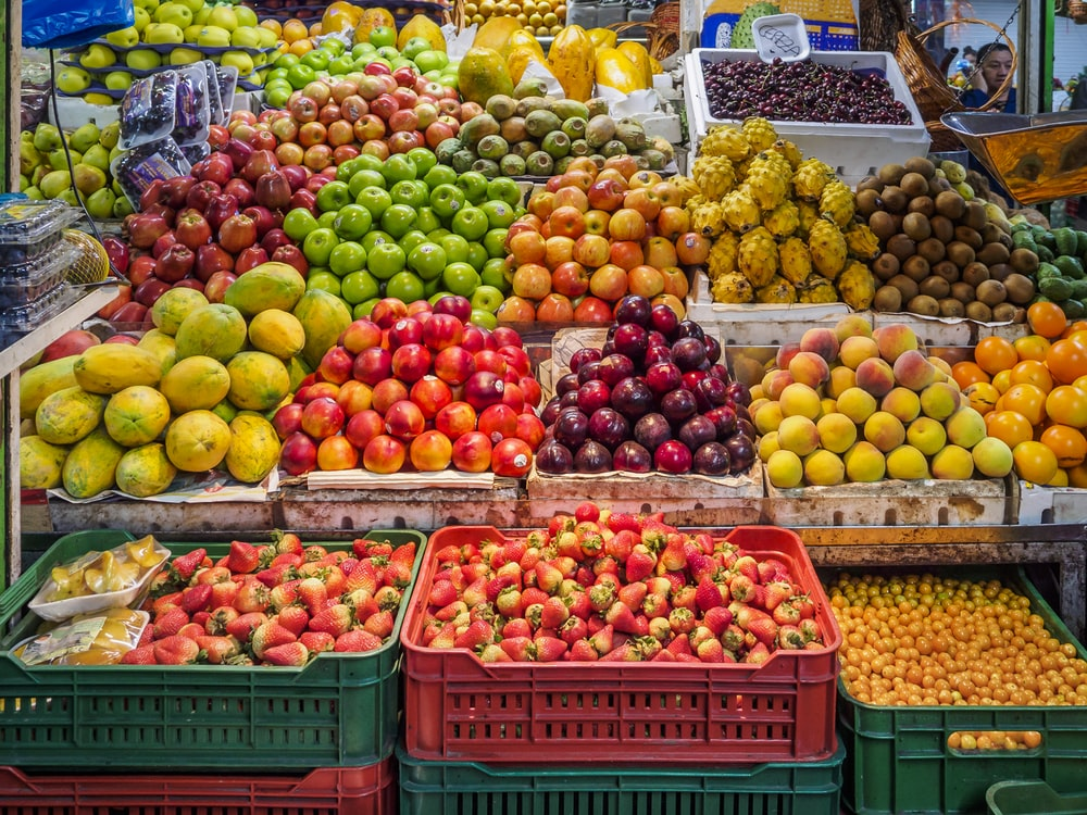 red and green apples on red plastic crate