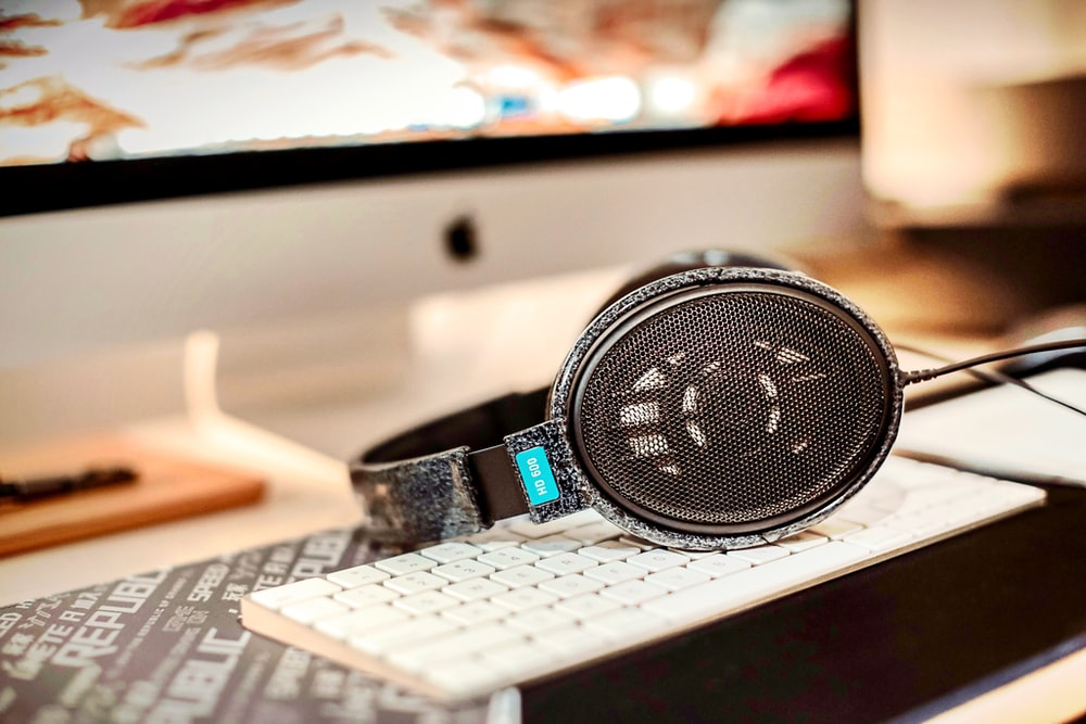 black and silver round watch on silver macbook