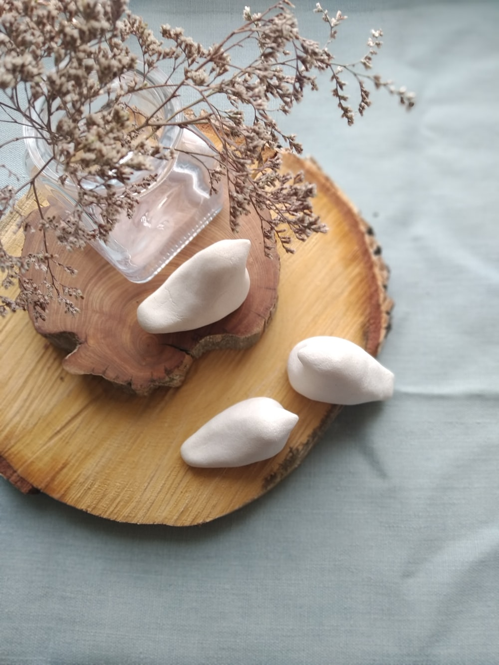 sliced bread with white cream on brown wooden round plate