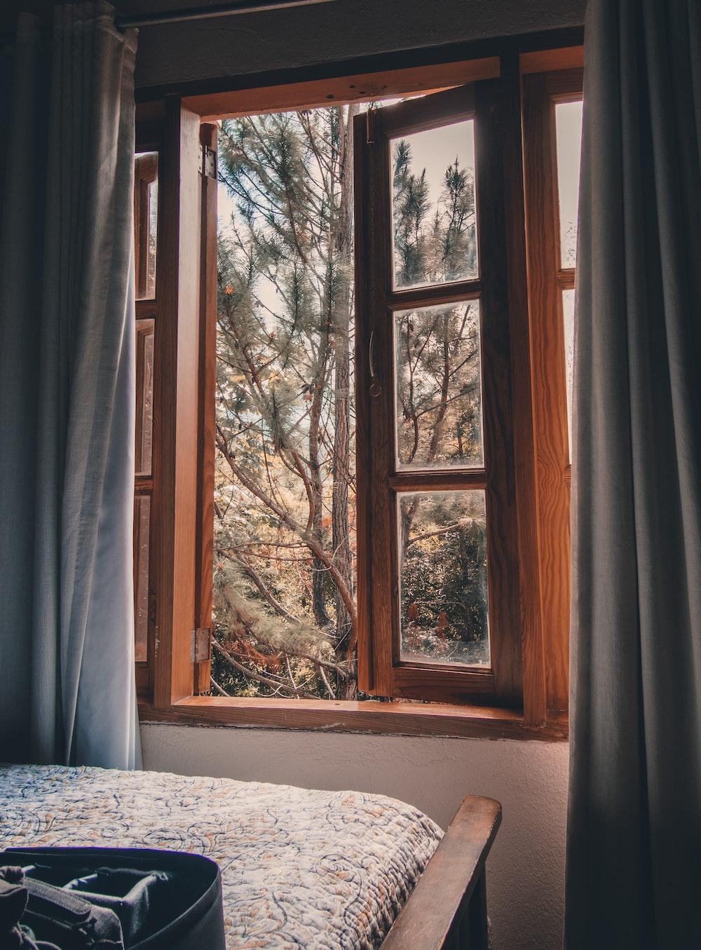 white window curtain near white wooden framed glass window