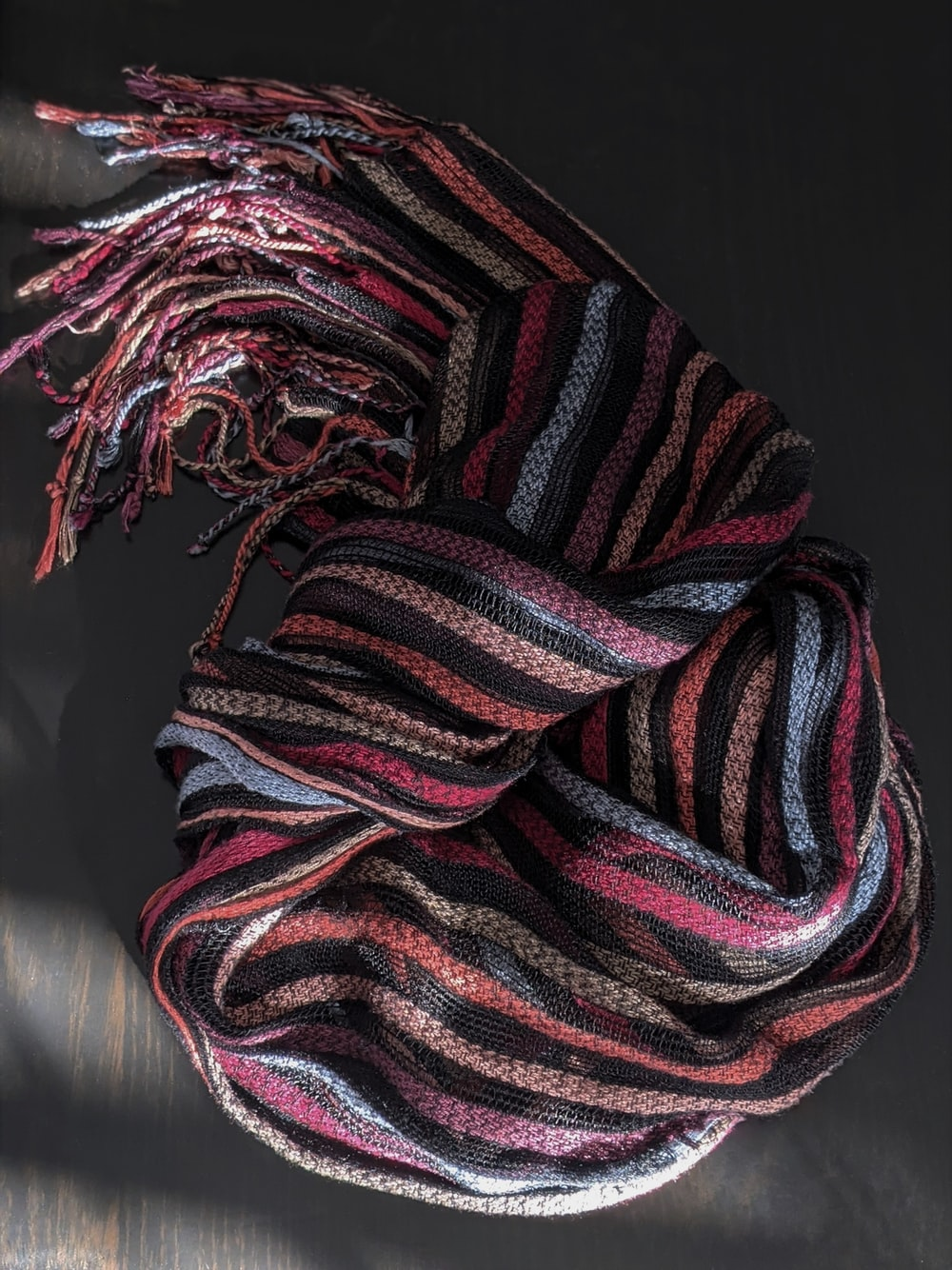 red and black striped textile