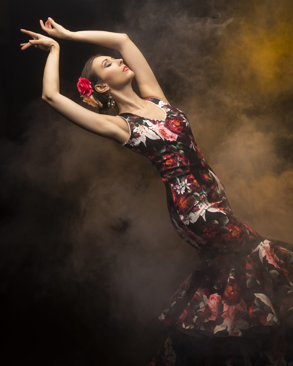 woman in black red and white floral dress