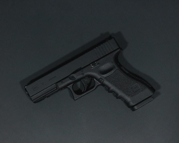 black semi automatic pistol on gray surface