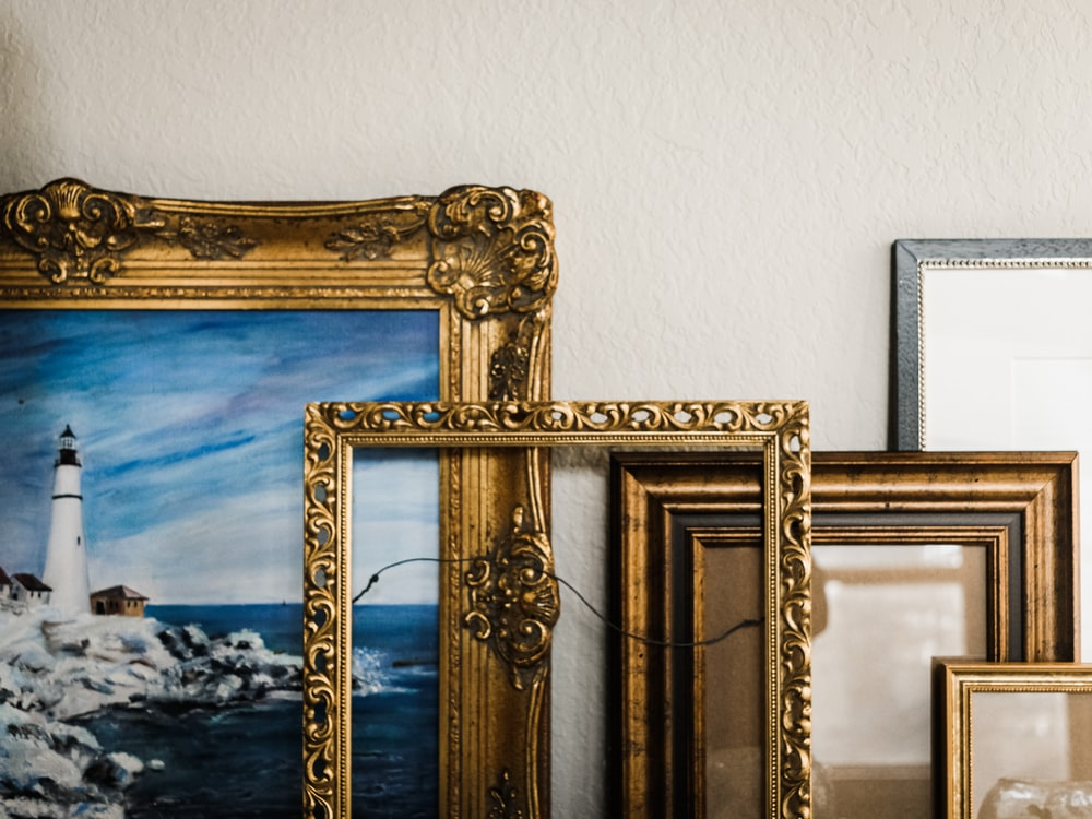 gold framed mirror on white wall
