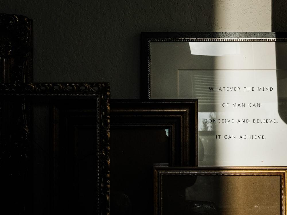 white printer paper on brown wooden frame