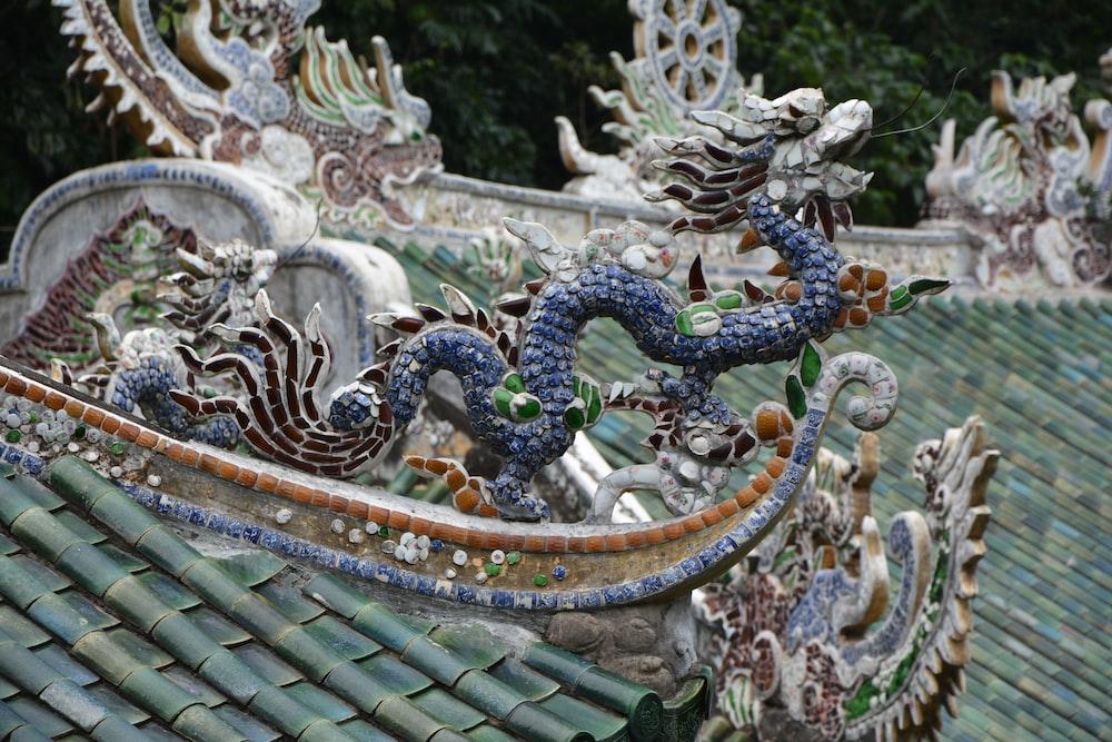 white and blue dragon statue