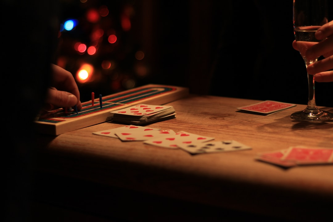 playing cards on brown wooden table
