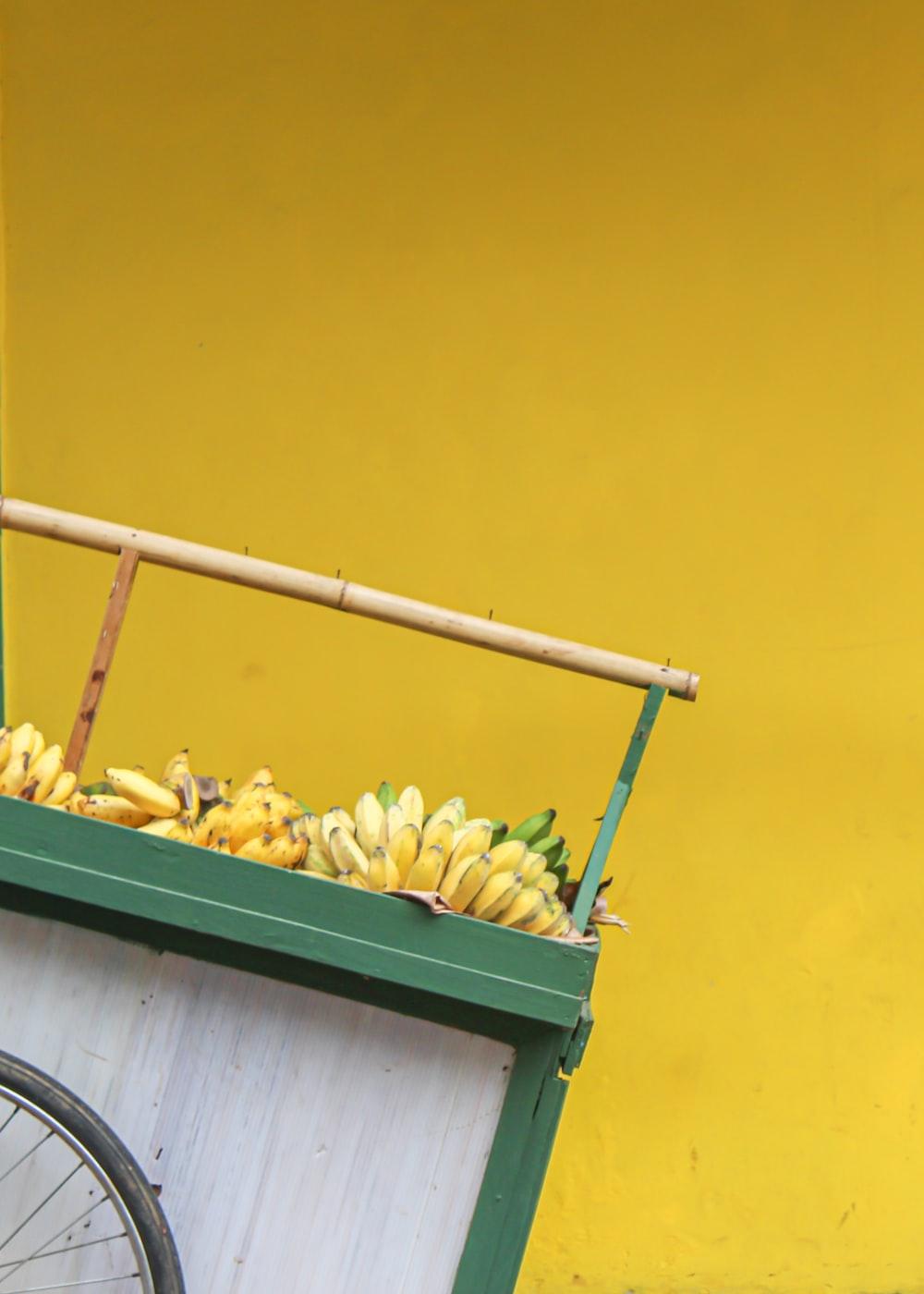 yellow banana fruit on green wooden wall