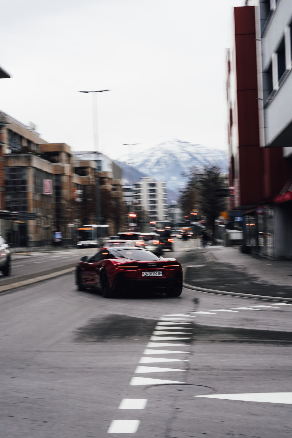 red car on road during daytime