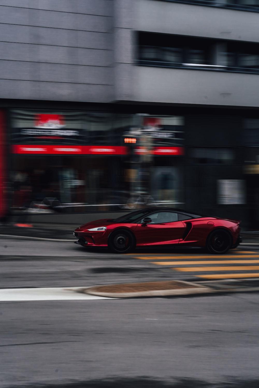 red ferrari 458 italia on road during night time