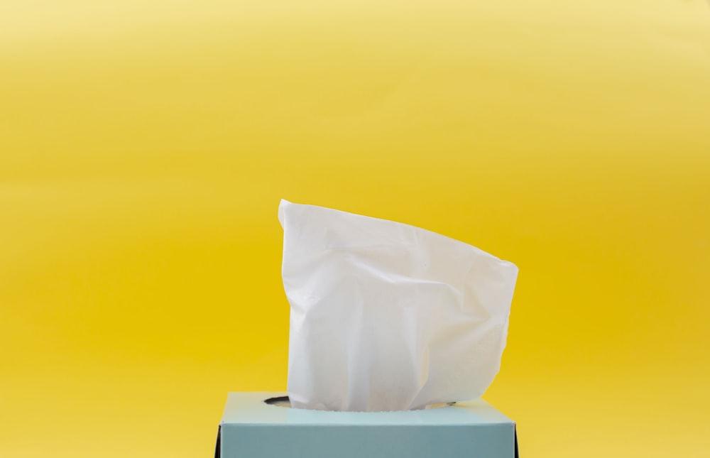 white tissue paper in blue box