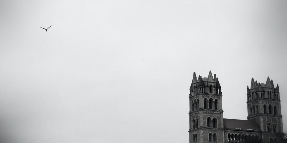 gray concrete building under white sky during daytime