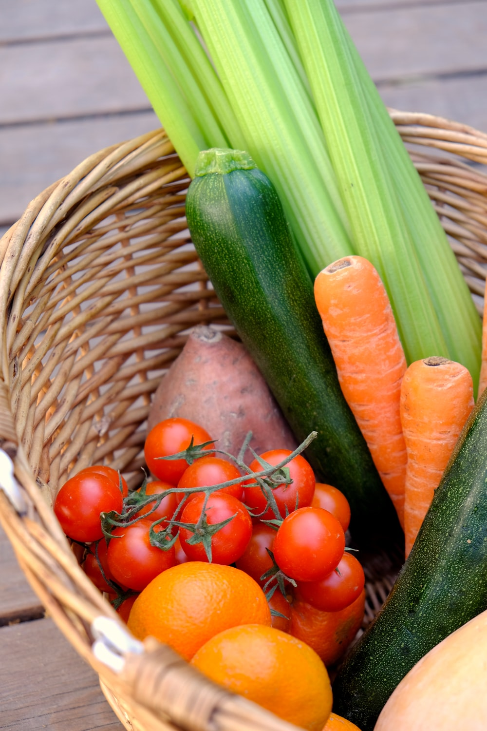 carrots and cucumber on brown woven basket