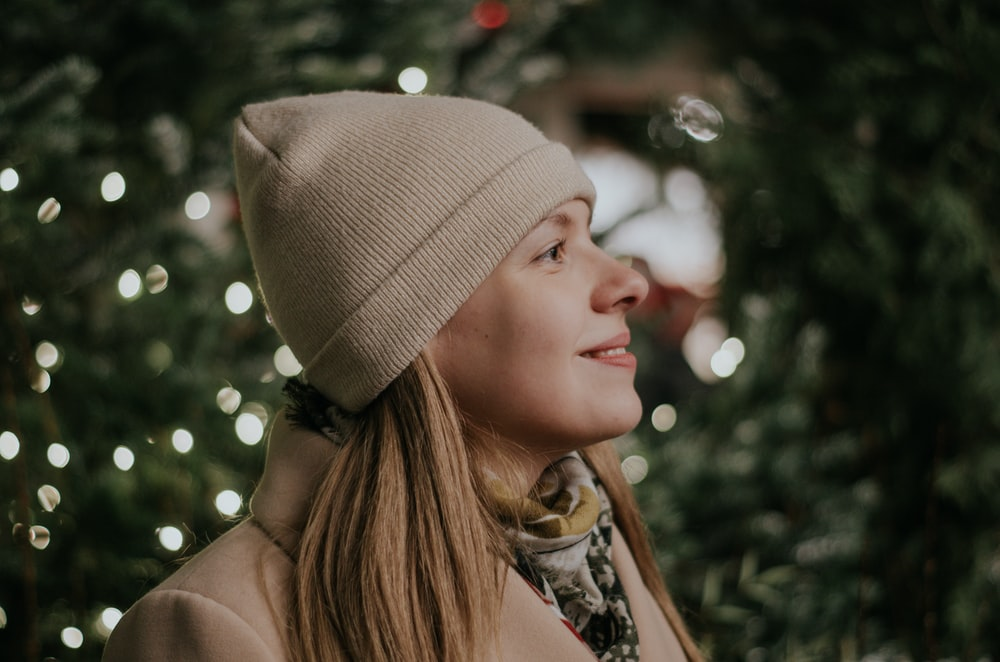 woman in white knit cap