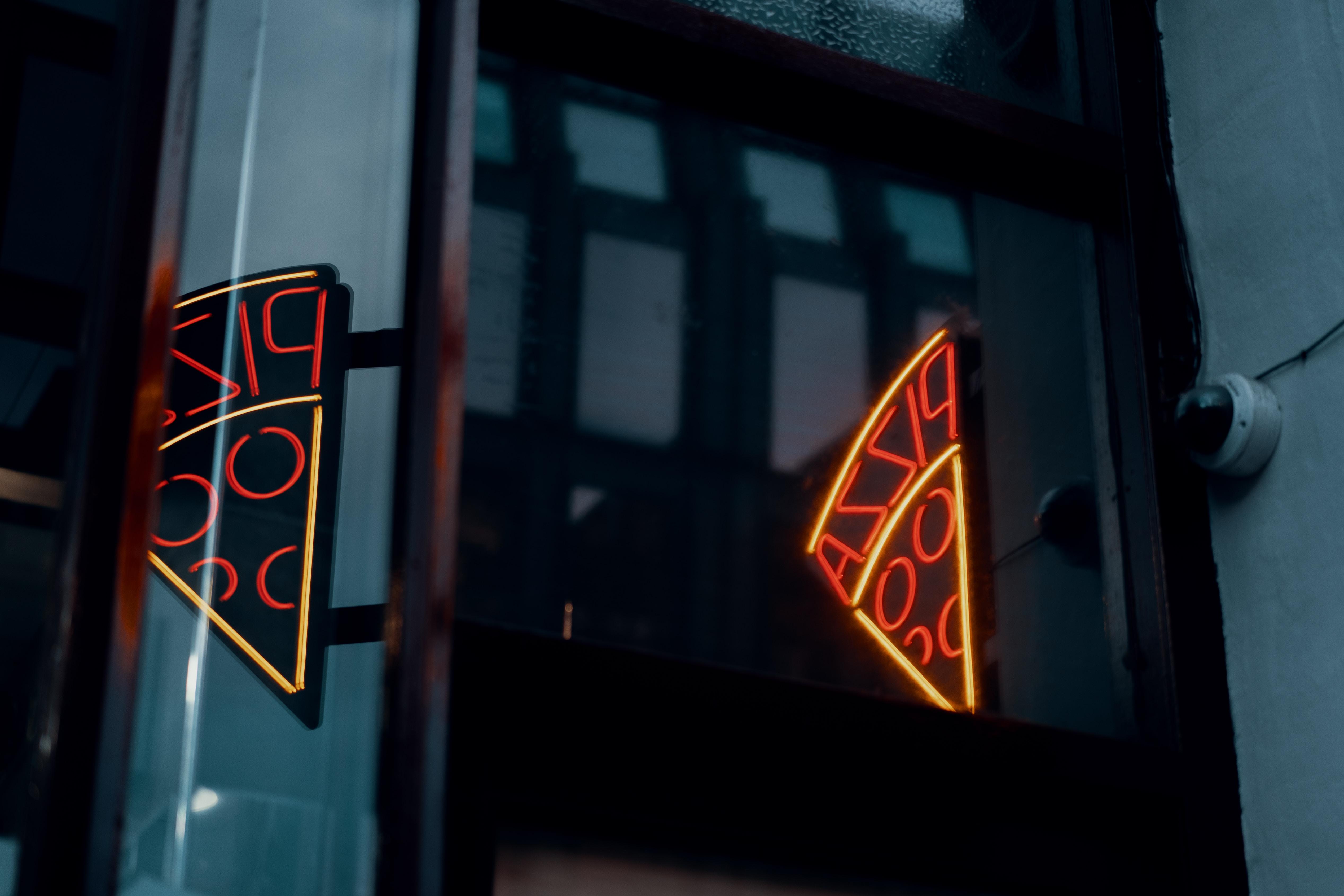 A neon pizza slice