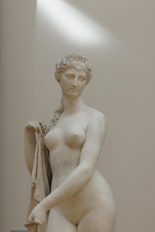 white ceramic statue of a woman